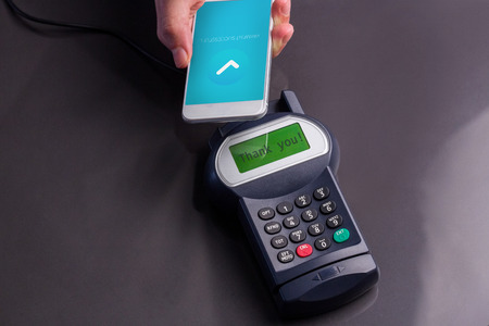 pay phone: Mobile phone screen showing payment successful against man using smartphone to express pay