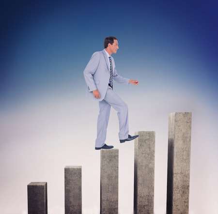 side bar: Side view of businessman walking on white background against bar chart depicting growth
