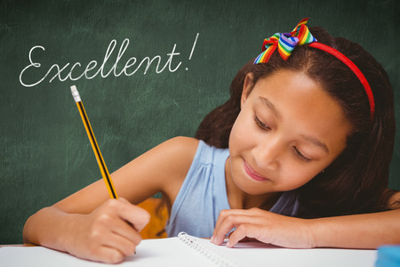 uitstekend: The word excellent! and pupil writing against green chalkboard