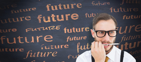 geeky: Geeky hipster biting on pencil against blackboard Stock Photo