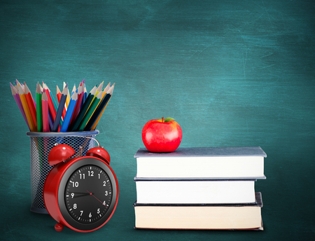green chalkboard: School supplies against green chalkboard Stock Photo