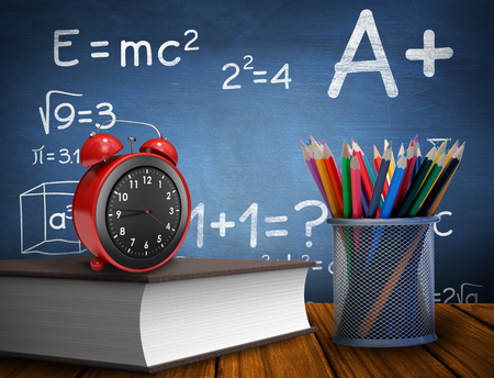 school exam: School supplies against blue chalkboard