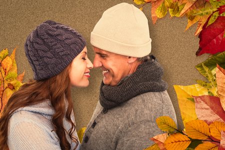 facing each other: Couple in warm clothing facing each other against autumn leaves pattern