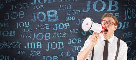 geeky: Geeky businessman shouting through megaphone against blackboard
