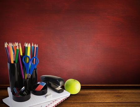 school desk: School supplies against desk Stock Photo
