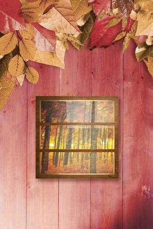 composite image: Composite image of closed glass window against autumn leaves pattern