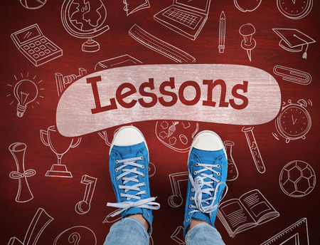 lessons: The word lessons and casual shoes against desk Stock Photo