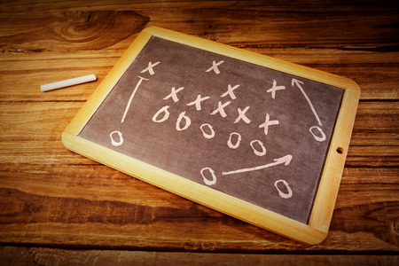school strategy: tactics against chalkboard on desk Stock Photo
