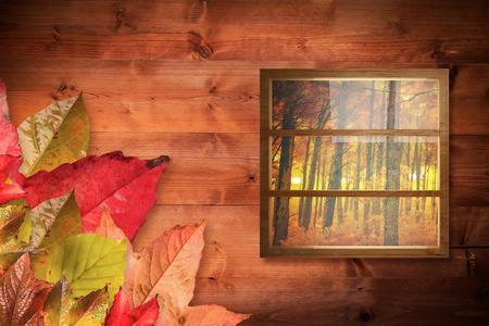 autumn scene: Composite image of closed glass window against autumn scene