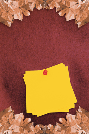 inscribe: Sticky note with red pushpin against autumn leaves pattern Stock Photo