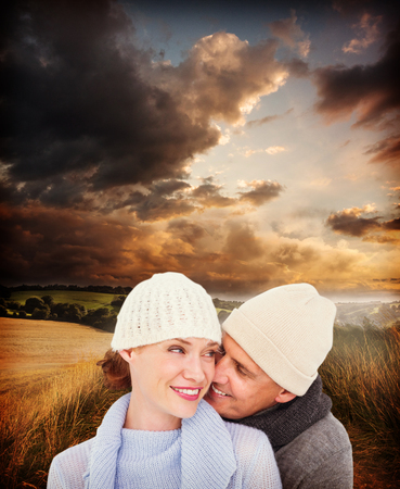 warm clothing: Casual couple in warm clothing against country scene