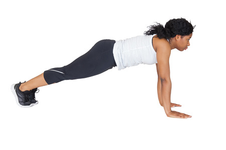 push: Fit woman doing push up on white background Stock Photo