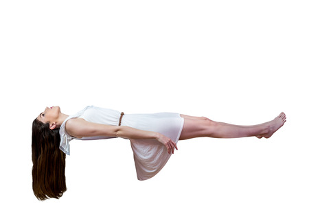 flying float: Girl in white dress floating in air on white background
