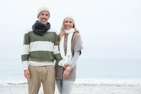 short wave: Cute couple standing together at the beach
