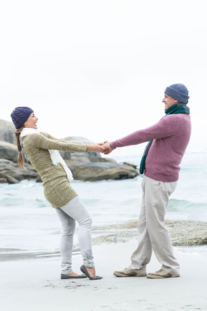 middleaged: Smiling happy couple hugging each other at the beach Stock Photo
