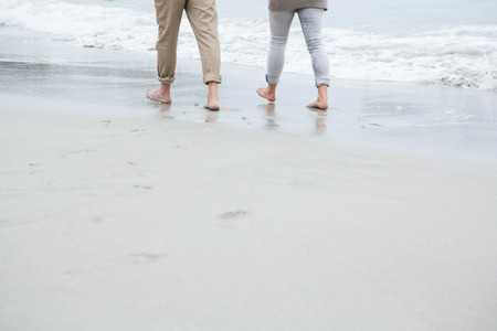 short wave: Cute couple walking together at the beach