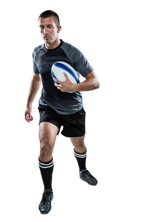 sportsperson: Full length of sports player running with ball against white background Stock Photo