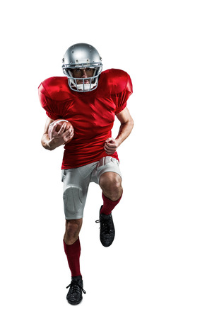 cut the competition: Full length portrait of American football player in red jersey running against white background