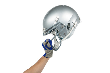 cropped out: American football player handing his helmet on a white background