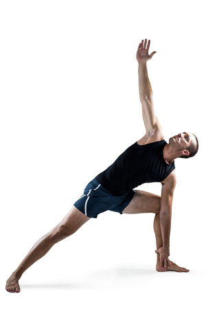 athleticism: Full length of trainer stretching against white background