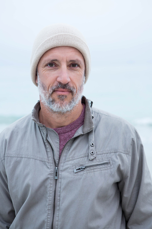 short wave: Close up of a man wearing at hat at the beach Stock Photo