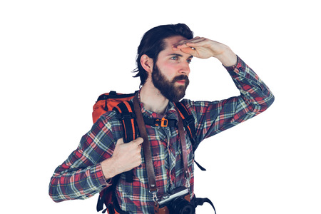 adventurer: Serious adventurer looking away against white background