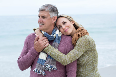 short wave: Smiling happy couple hugging each other at the beach Stock Photo