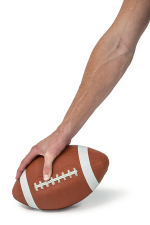 cut wrist: Close-up of American football player placing the ball against white background