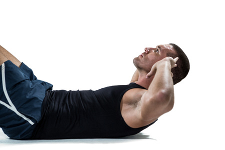 sit up: Determined athlete doing tummy crunches against white black Stock Photo