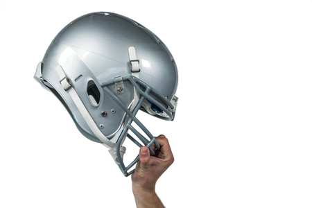 sliver: Cropped image of American football player handing his sliver helmet on white background