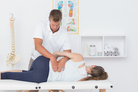 Doctor examining man back in medical office Stock fotó - 45303111