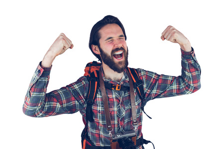 adventurer: Excited adventurer with arms raised against  white background