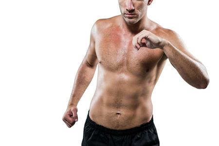 athleticism: Midsection of shirtless athlete exercising against white background Stock Photo