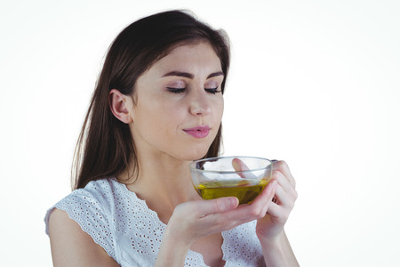 herbal background: Pretty woman with herbal tea on white background
