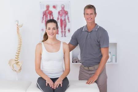 Happy doctor with his patient in medical office Stock Photo