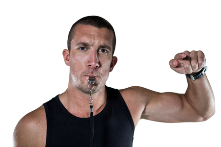 job training: Portrait of attentive trainer blowing his whistle against white blackground