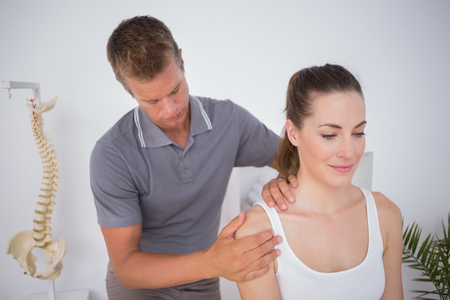 Doctor examining his patient arm in medical office Stock Photo