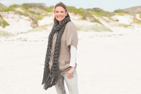 scarf beach: Smiling woman wearing a scarf at the beach Stock Photo