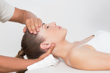 physiotherapy: Woman receiving neck massage in medical office Stock Photo