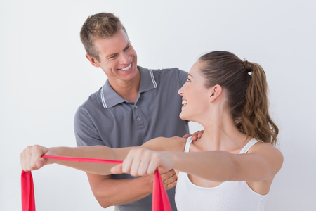physiotherapy: Doctor examining his patient back in medical office Stock Photo