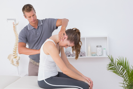 chiropractic: Doctor doing neck adjustment in medical office