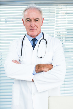 gynaecologist: Portrait of doctor with stethoscope around his neck at clinic