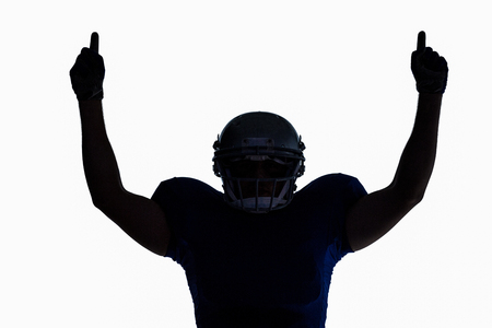 cut the competition: Silhouette American football player with thumbs up against white background