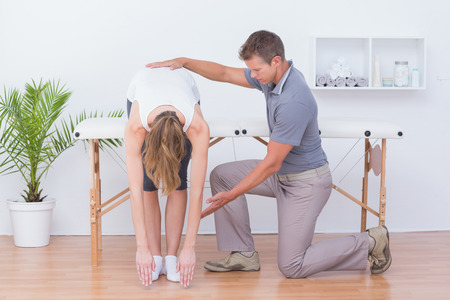 spinal adjustment: Doctor stretching a woman back in medical office