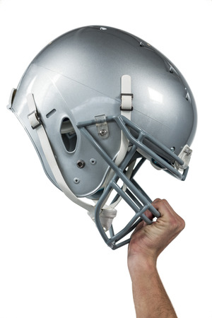 sliver: Close-up of American football player handing his sliver helmet on white background Stock Photo
