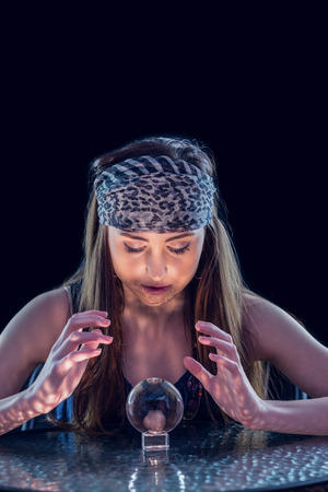 crystal background: Fortune teller using crystal ball on black background
