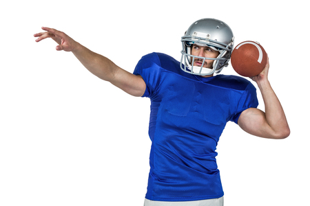 cut the competition: American football player about to throw the ball on white background Stock Photo