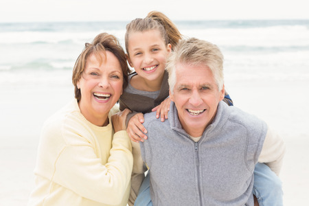 grandparents: Grandparents with their granddaughter at the beach
