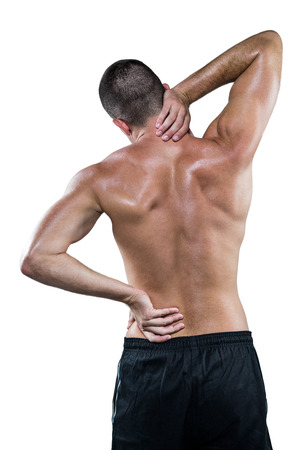back sprains: Rear view of shirtless athlete with neck pain over white background Stock Photo