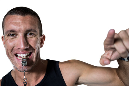 career job: Close-up of attentive trainer blowing his whistle against white blackground Stock Photo